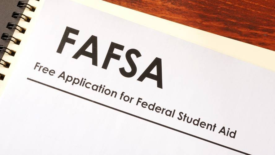 Paper copy of FAFSA application on wood desk