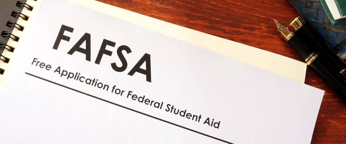 FAFSA form on wood desk